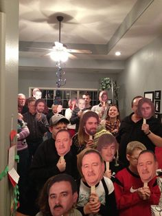 For a surprise Birthday, he walked into everyone holding pictures of him from different times in his life! Ah-mazing idea!