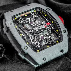 One of the most insanely complex and impressive time only watches ever made: Richard Mille RM 27-01.  The ultra low weight is impressive, but my favorite bit is the suspended movement, levitating inside the case.