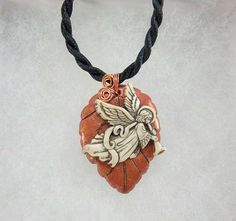 Check out this item in my Etsy shop https://www.etsy.com/listing/200640581/angel-pendant-polymer-clay-angel-button