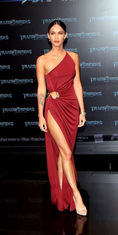 When you've got it, flaunt it. Megan wowed in a strategically skin-baring Roberto Cavalli gown in 2009.