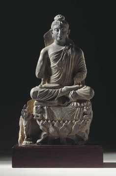 A Gray Schist Figure of Buddha on Lotus Throne - GANDHARA, 2ND/3RD CENTURY.
