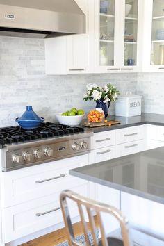 white cabinets + marble linear backsplash + gray quartz