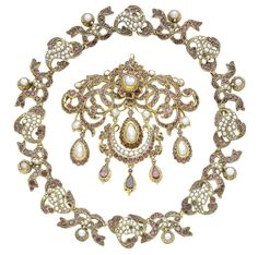 A silver gilt, pearl & garnet necklace & pendant, c. 1801-1850.  The collar necklace designed as series of stylised vine leaves alternating with ribbon bows, set throughout with vari-cut garnets & seed pearls, each ribbon bow suspending a pearl drop in an engraved collet, the similarly-set girandole brooch with baroque pearl & pear-shaped garnet drops, mounted in silver gilt, closed-back settings throughout, pendant converted from a stomacher/brooch.