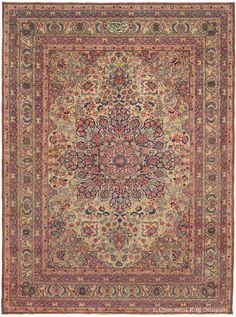 LAVER KIRMAN, Southeast Persian, 8ft 9in x 11ft 6in, Circa 1875. Signed by the highly respected weaver, Tausensian, this exceptionally nuanced Laver Kirman antique carpet is a masterwork of refined elegance, standing out even among the numerous exquisite examples of this well-respected Court style. Its entrancing, multi-layered medallion is animated by a resplendent assortment of tiny, individually crafted flowerheads, each radiating toward equally painstaking cornerpieces and borders.