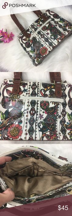 """Sakroots Owl Peace Purse with Brown Leather Sakroots purse / handbag • Multicolored owl print • Plastic coated canvas • Leather bottom and handles • 2 zippered compartments and two metal closure compartments • Outside zippered pocket • Excellent condition - like new • Height-8"""", Width-11"""", Length-3"""" Sakroots Bags Shoulder Bags"""