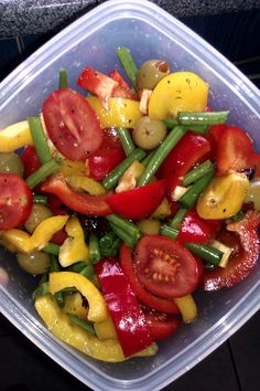 My healthy packed lunch: green beans, pomodoro tomatoes, red and yellow peppers, olives, a few cranberries, lemon juice, balsamic and olive oil.