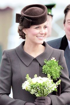 Only because I am obsessed with her I noticed the last two years she wore green and this year she is wearing brown. Love the up do and hat.