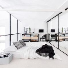 This bedroom is dreamy. Get the look with a low bed with white bedding and a black blanket.