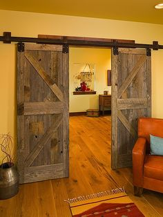 "Barn doors are great solution for partitioning off areas when you are space limited. Could you use one in your home? Discover more ideas by viewing our ""Doors and Windows"" album on our site at http://theownerbuildernetwork.co/ideas-for-your-rooms/doors-and-windows-gallery/doors-and-windows/-SR"