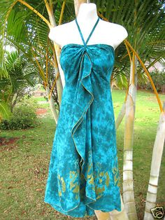 Turquoise tropical dress that matches #Belize's beautiful waters.