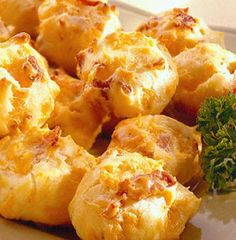 Bacon cheddar puffs 1 cup milk cup butter 1 cup all-purpose flour 4 large eggs 1 cup Sargento Fine Shredded Sharp or Mild Cheddar Cheese 8 slices bacon, cooked crisp, crumbled tsp. onion salt or powder teaspoon garlic salt teaspoon pepper~ Samosas, Empanadas, Think Food, Love Food, Bacon Cheddar Puffs, Cheese Puffs, Cheddar Biscuits, Breakfast Desayunos, Puff Recipe