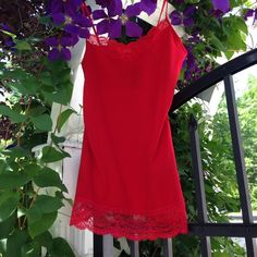 💥SALE💥Express Red Top or Camisole with Lace Wow Factor! Gorgeous red top with lace trim at top and bottom hem. Can be used as a undergarment, top under another shirt or alone. 95 percent cotton/5 percent spandex Express Tops Camisoles