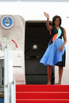 Pin for Later: Melania Trump Is Accused of Plagiarizing Michelle Obama's Speech — While Wearing 1 of the First Lady's Favorite Designers Michelle Obama Wearing Roksanda Leaving Cambodia in a colorblock look in 2015.
