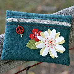 think how much safer all that loose change in my purse would feel if it were being held and contained in the comfort of this little pouch.