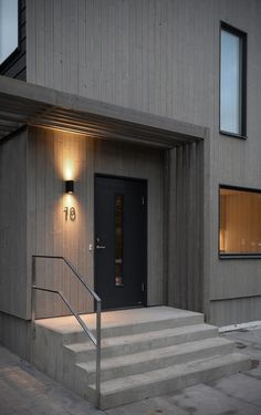 Sweco's architects have designed the Vårvetet residential development in Hagsätra, a suburb of Stockholm. Modern Outdoor Wall Lighting, Entrance Lighting, Entrance Doors, Minimal House Design, Porche, Construction, Design Hotel, House Goals, House Colors