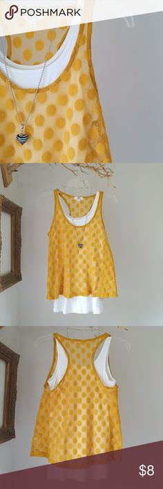 Mustard Racer Back Tank Here a dot, there a dot, everywhere a dot dot... No stains, rips or tears, but a lil pilling. White camisole not included.  **Please note. ..Items listed are in pre-loved condition (unless noted as NWT). I sincerely looks over all the details; however, I encourage you to ask for additional details before making a purchase. ** Iris Basic Tops