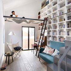 Check this out!  I found this photo of a home library with a sliding ladder and an overhead hammock!  Awesome!  I would love to have this in my house.  Do you think this would be a fun place to read? . . . #bookshelf #homelibrary #booknerd #bibliophile #readeverywhere #readanywhere #bookstagram #booklove #booklover #bookaddict #library Source: http://www.egueyseta.com
