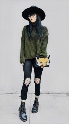 Hat with glasses, green sweater, ripped black pants, fishnet tights & Dr Martens boots by jaglever