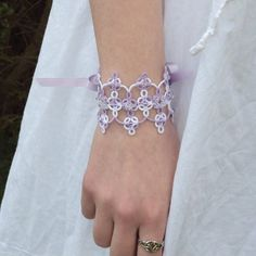 I'm thinking tatted edging.  Fantasy Bridal Lace Cuff in Tatting  Guinevere by TataniaRosa