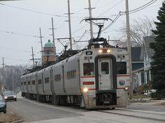 NICT Interurban/commuter train - street running down 11th Street in Michigan City, Indiana