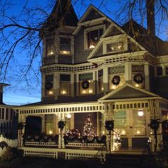 So welcoming! I love old Victorians with lights in every window.