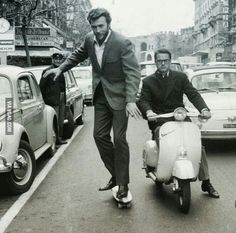 You may be cool, but you're not Clint Eastwood skateboarding down a Rome street in formal attire cool. (Circa 1965)