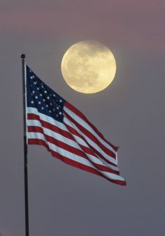 Full moon over. . .this is my country, land that I love. . . I pledge thee my allegience. . . America.