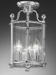 LA7000/3 Pasillo 3 light flush lantern in chrome and curved glass. 3 x 60w E14 Candle Lamps not included  Height- 36cm Diameter- 21cm Weight- 2.5Kg  BRAND- Franklite REFERENCE- LA7000/3 AVAILABILITY: 3-4 Working Days **Can be supplied with am integrated FRANKLED solution ** Can be supplied with integrated 3hr maintained emergency lighting gear **Where an integrated LED solution is required it can be supplied as a dimmable unit Please ring 01793 616018 if you are interested in getting a…