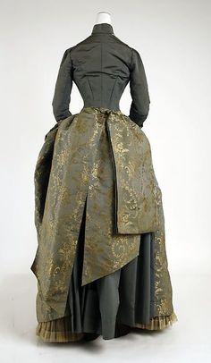 Dress Date: ca. 1885 Culture: American Medium: silk Dimensions: (a) Length at CB: 17 in. (43.2 cm) (b) Length at CB: 40 in. (101.6 cm) Credit Line: Gift of Miss Alexandra Francesca, 1955