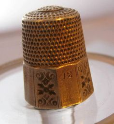~ Vintage Thimble ~would be a great thing to collect.  Small & useful.