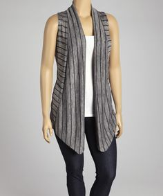 Master a layered look in this cozy vest. The open style leaves plenty of room for versatile pairing, while draped texture provides a decadent touch for any look.