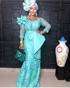 If there is one element that is always present in nigeria fashion,it is glorious Aso Ebi styles.which is equally loved by women and men and is the number one thing to wear to weeding and other special occasions. Nigerian Lace Styles, African Lace Styles, African Lace Dresses, Latest African Fashion Dresses, African Dresses For Women, African Print Fashion, Ankara Styles, Ankara Tops, Ankara Designs