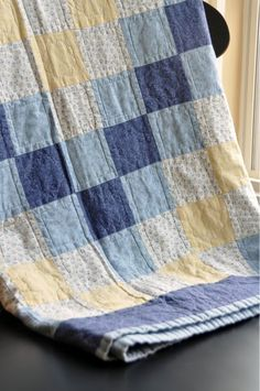 pretty faded quilt in blues & yellow