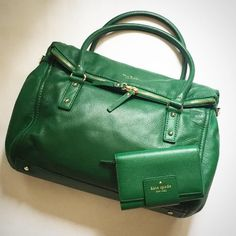 Gorgeous Rare Kate Spade Cobble Hill Leslie -Large This is an absolutely amazing emerald green leather, very soft pebbled leather with bright gold tone hardware. Embossed gold logo with little gold spade emblem on front. Double zip across top and folds over secured by a magnet inside. Stays closed, very secure bag. Shoulder style,  not crossbody. Black and white stripe lining in front pocket and interior. Inside zipper pouch. Gently loved - amazing condition. kate spade Bags Shoulder Bags