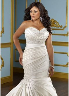 If you are full figured AND have an hourglass shape as I do, then this wedding dress style is for you. Dress by Mori Lee in their Plus Sized line. Retailing around $1000.