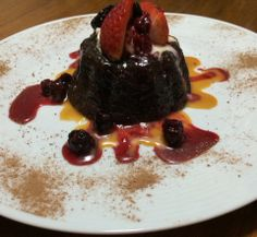Flourless Chocolate Cake with Salty Caramel sauce served with Berry Compote