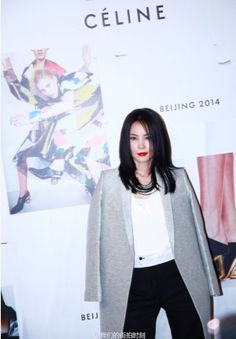 Faye Wong, from Hong Kong at CELINE event in Beijing, May 2014   One of the most stylish women from HK. with an attitude x