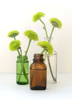 vases - table decor  Great idea for those little bottles you pick up at yard sales!!!