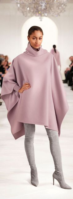 The graceful Ralph Lauren Collection Lawson cape is crafted in Italy from a double-faced wool-and-cashmere blend and features a stunning asymmetrical funnel neckline with mother-of-pearl buttons.: