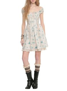Available 2/24Disney Cinderella exclusive Hot Topic collection peasant print dress with ribbon lace bust, lace-up corset bodice, lace-up back and accordion pleated chiffon underskirt.