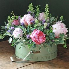 Rose and ivy floral decor centerpiece in a hatbox type container. Very vintage retro style and so cute!