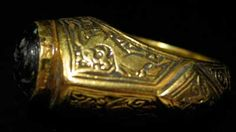 Seljuk Gold Ring Featuring a Garnet Seal Depicting a Bird - OS.157, Origin: Mediterranean, Circa: 1100 AD to 1200 AD Style: Seljuk. In the 9th century, hordes of nomadic Turkic horseman living on the outskirts of the Muslim world began to migrate westward into the heart of Central Asia. By the 10 century, a branch known as the House of Seljuk had broken off from the Oghuz confederation of Turkomen tribesmen, arrived into mainland Persia, and settled in the province of Khurasan. Overtime…