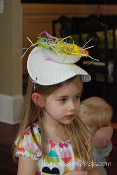 First Day of Spring Hat: paper plate, bowl glued on top, filled with paper grass and pom poms for chicks