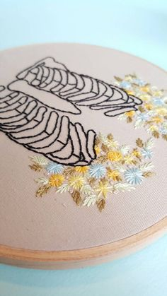 Hand Embroidered Floral Anatomical Rib Cage by TomstitcheryThreads