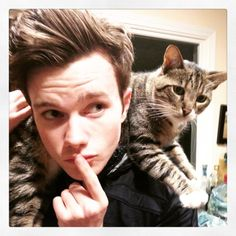 hrhchriscolfer: Behind every great man…is a cat who makes him feel obsolete.
