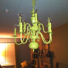 Spray painted chandelier with round light bulbs