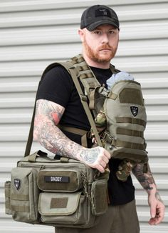 Tactical Baby Gear for Dads Tactical Baby Gear Deuce and Tactical Baby Carrier in Ranger Green. Best baby gear for new Dads. Essential diaper back check list available. Various diaper bags for dads, in Black Camo, Ranger Green, Coyote Brown and Black. Dad Diaper Bag, Diaper Bag Backpack, Diaper Bags For Dads, Camo Diaper Bags, Best Diaper Bag, Baby Must Haves, Bag Sewing, Baby Shooting, Bag Essentials