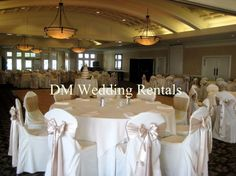 ivory chair covers with satin sand sashes