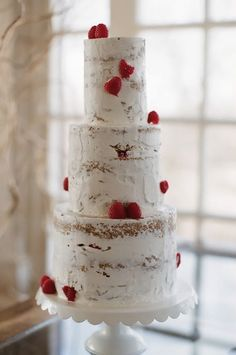 "Raspberry Wedding Ideas. That is a nice one. I have to laugh, all this time we try to cover our cake thoroughly and here, not covering it, looks great. The ""on purpose"" approach works!"