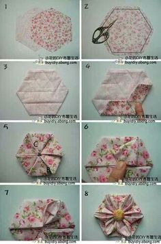 Folded fabric hexie flower. Do a quilt of these, or maybe just a hair bow or an upcycled clothing/handbag embellishment.